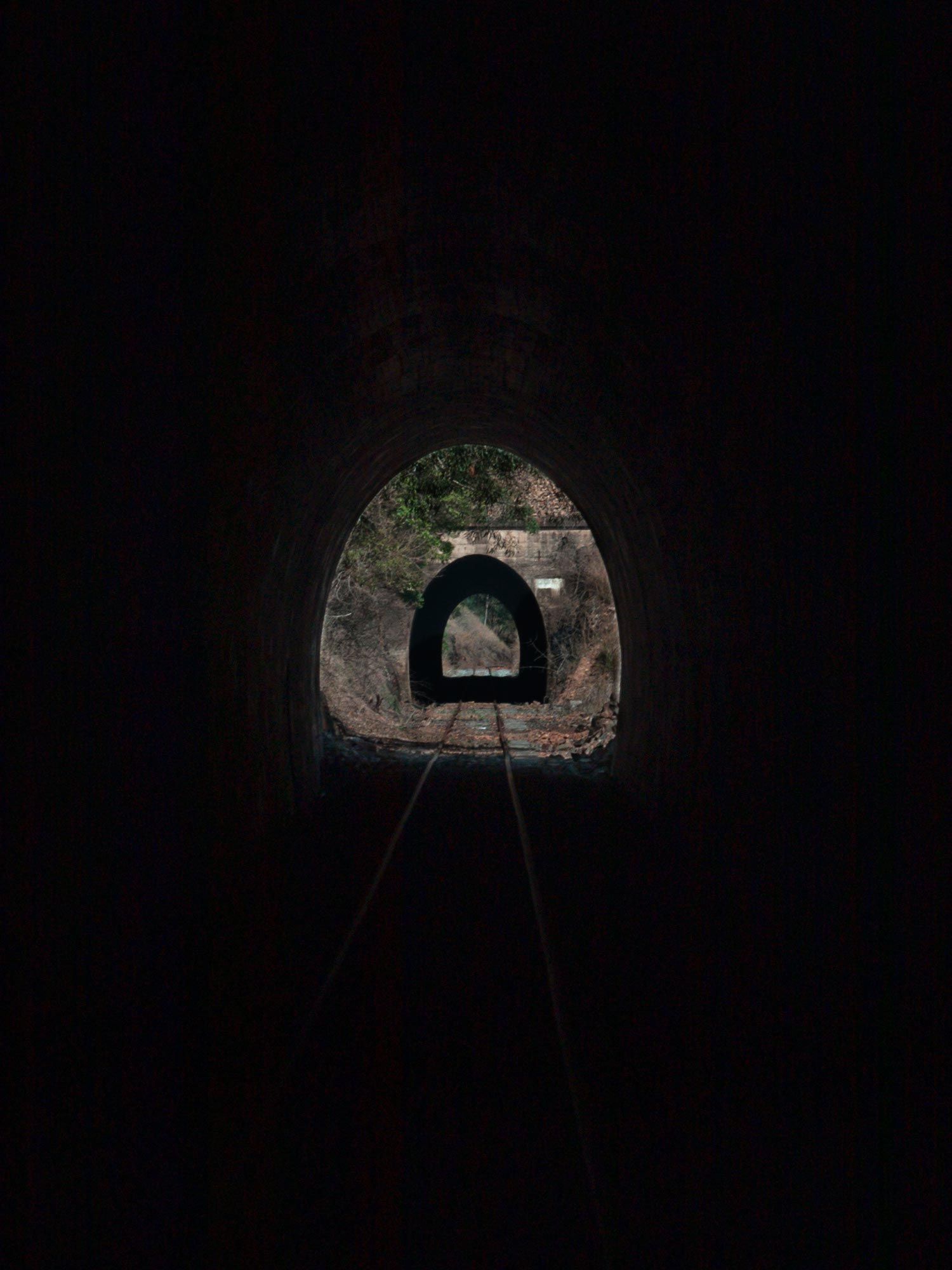 View through 2 rail trail tunnels