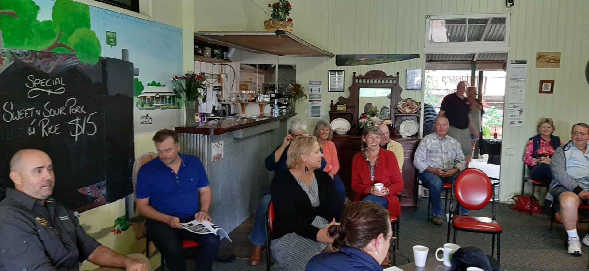 Members of Boyne Burnett Inland Rail Trail sitting, meeting Mungungo Pub