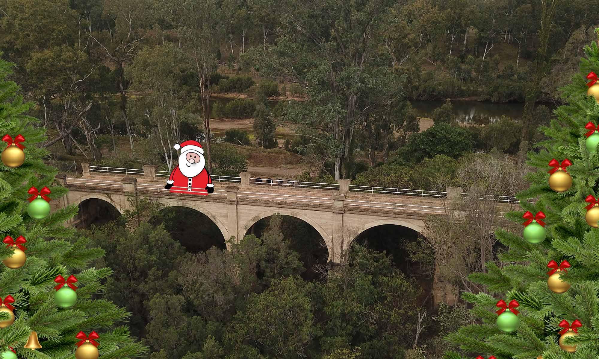 concrete arch bridge with santa and xmas trees