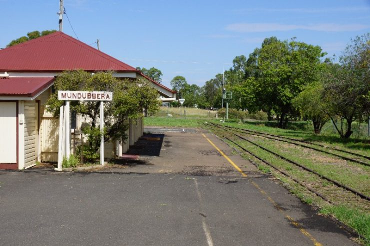 old railway station with red roof in a rural setting